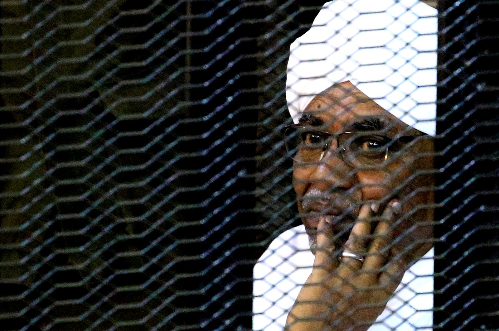 Sudan's former President Omar Hassan al-Bashir sits inside a cage at the courthouse where he is facing corruption charges, Khartoum, Sudan, Sept. 28, 2019. (Reuters File Photo)