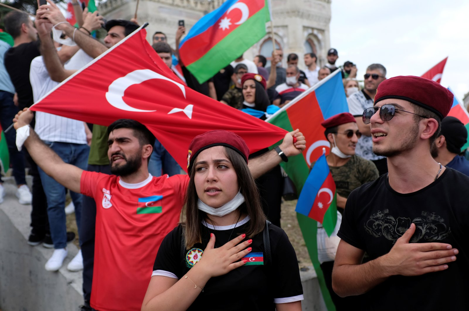 Azerbaijani youths living in Turkey sing Azerbaijan's national anthem during a protest following clashes between Azerbaijan and Armenia, in Istanbul, July 19, 2020. (REUTERS Photo)