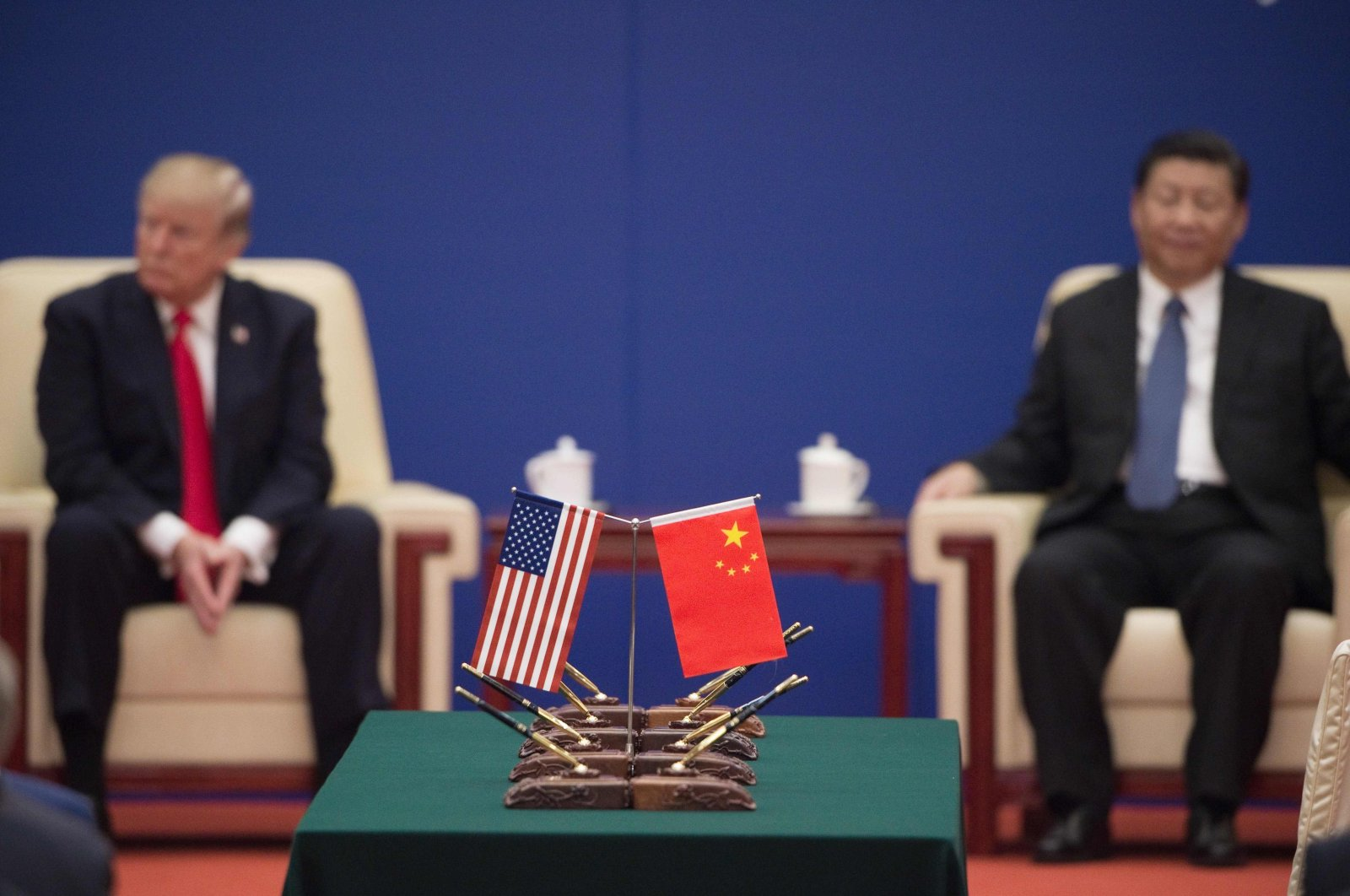 U.S. President Donald Trump and China's President Xi Jinping attend a business leaders' event inside the Great Hall of the People, Beijing, Nov. 9, 2017. (AFP Photo)