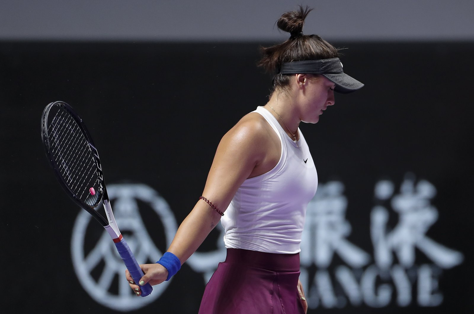 Bianca Andreescu reacts as she plays against Karolina Pliskova during the WTA Finals Tennis Tournament in Shenzhen, China, Oct. 30, 2019. (AP Photo)