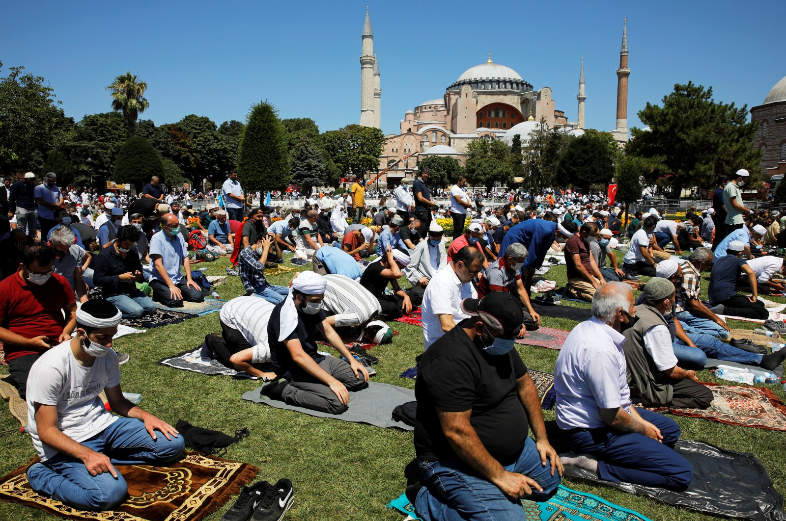Muslims attend Friday prayers outside Hagia Sophia Grand Mosque for the first time after it was reopened as a mosque after 86 years, Istanbul, Turkey, July 24, 2020. (REUTERS Photo)