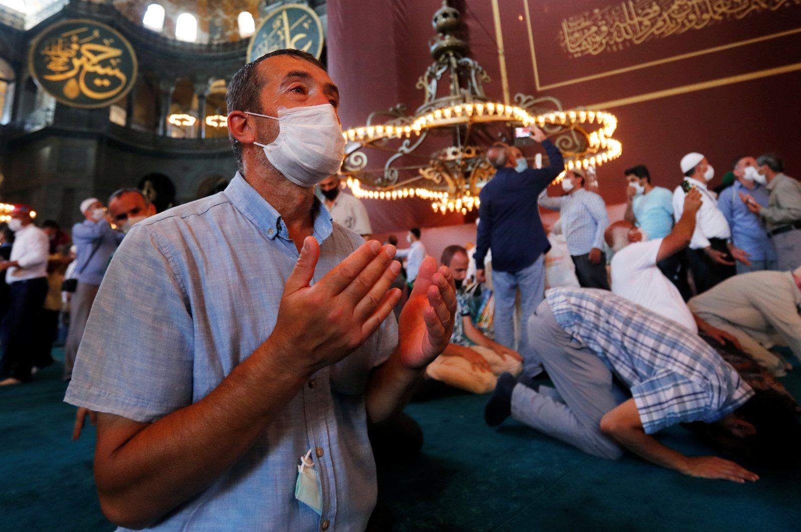 People pray as they visit Hagia Sophia Grand Mosque after Friday prayers, in Istanbul, July 24, 2020. (REUTERS Photo)