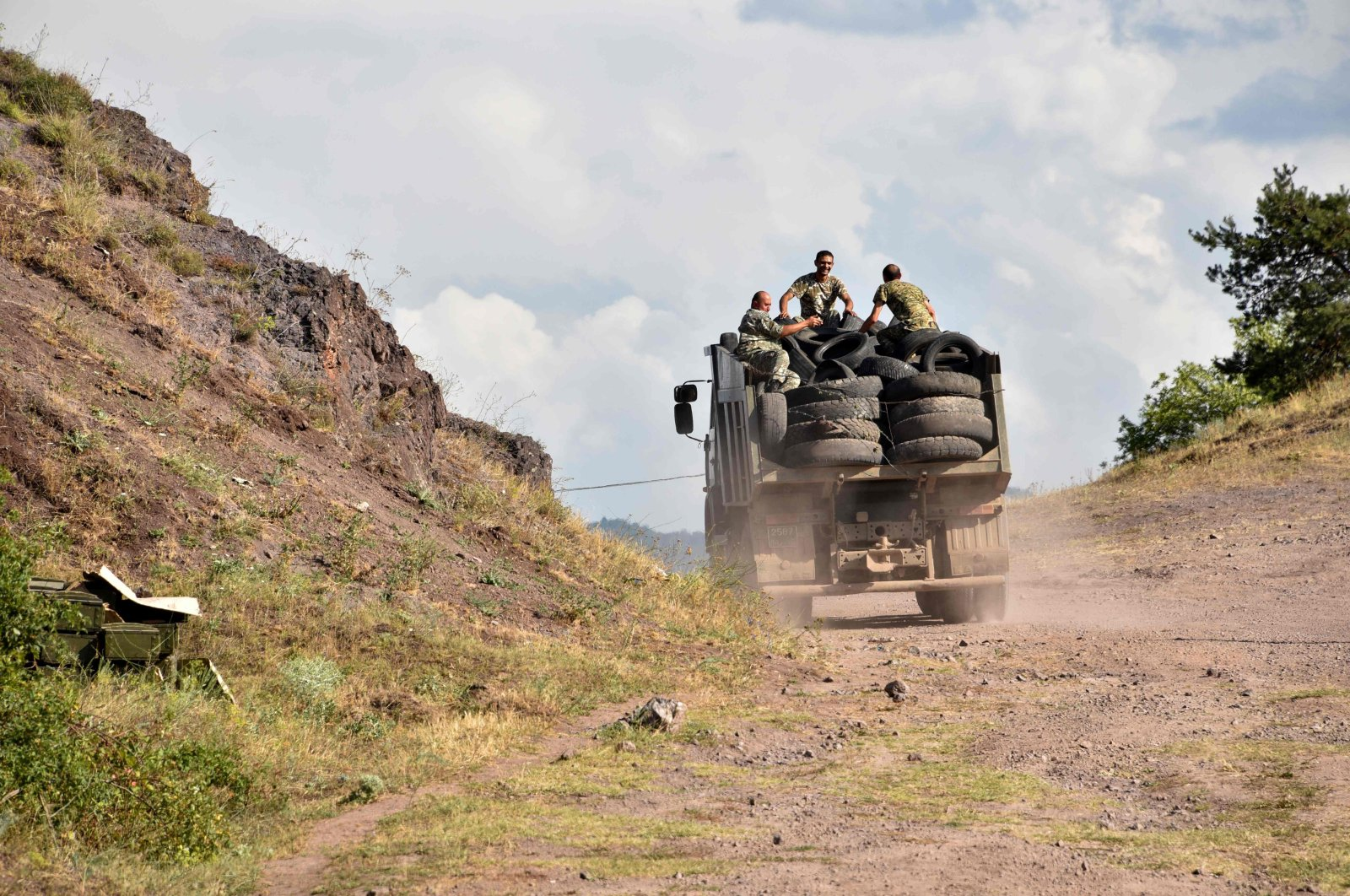 Armenian servicemen transport used tyres in the back of a truck to fortify their positions on the Armenian-Azerbaijani border near the village of Movses on July 15, 2020. (AFP Photo)
