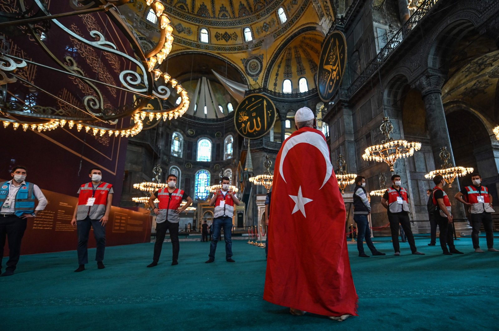 A man wrapped in a Turkish national flag visits the Hagia Sophia Grand Mosque in Istanbul, Turkey, July 24, 2020. (AFP Photo)