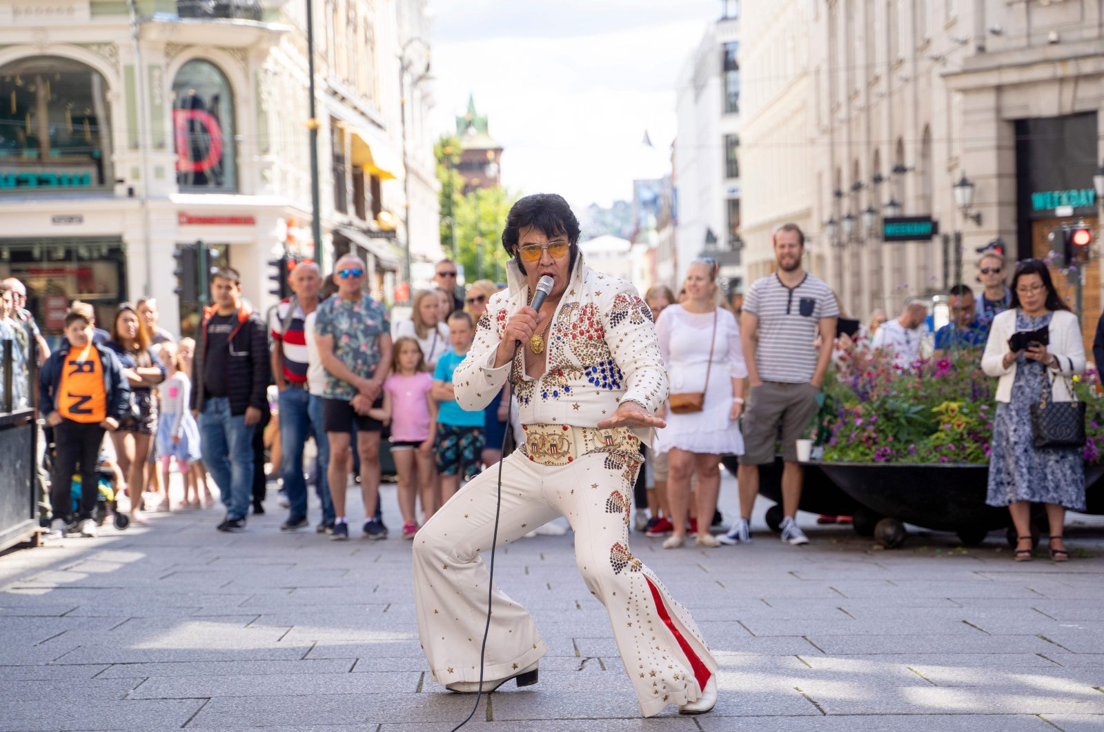 Norwegian artist Kjell Elvis (Kjell Henning Bjornestad) performs in central Oslo in an attempt to beat the record of the world's longest Elvis Presley singing marathon in Oslo, Norway on July 23, 2020. (AFP Photo)