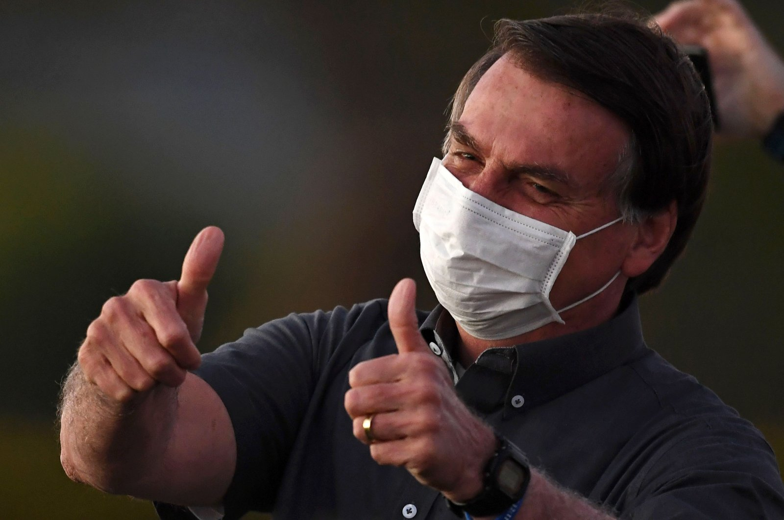 In this file picture taken on July 20, 2020 Brazilian President Jair Bolsonaro gives the thumbs up to supporters from the Alvorada Palace in Brasilia, amid the new coronavirus pandemic.(AFP Photo)