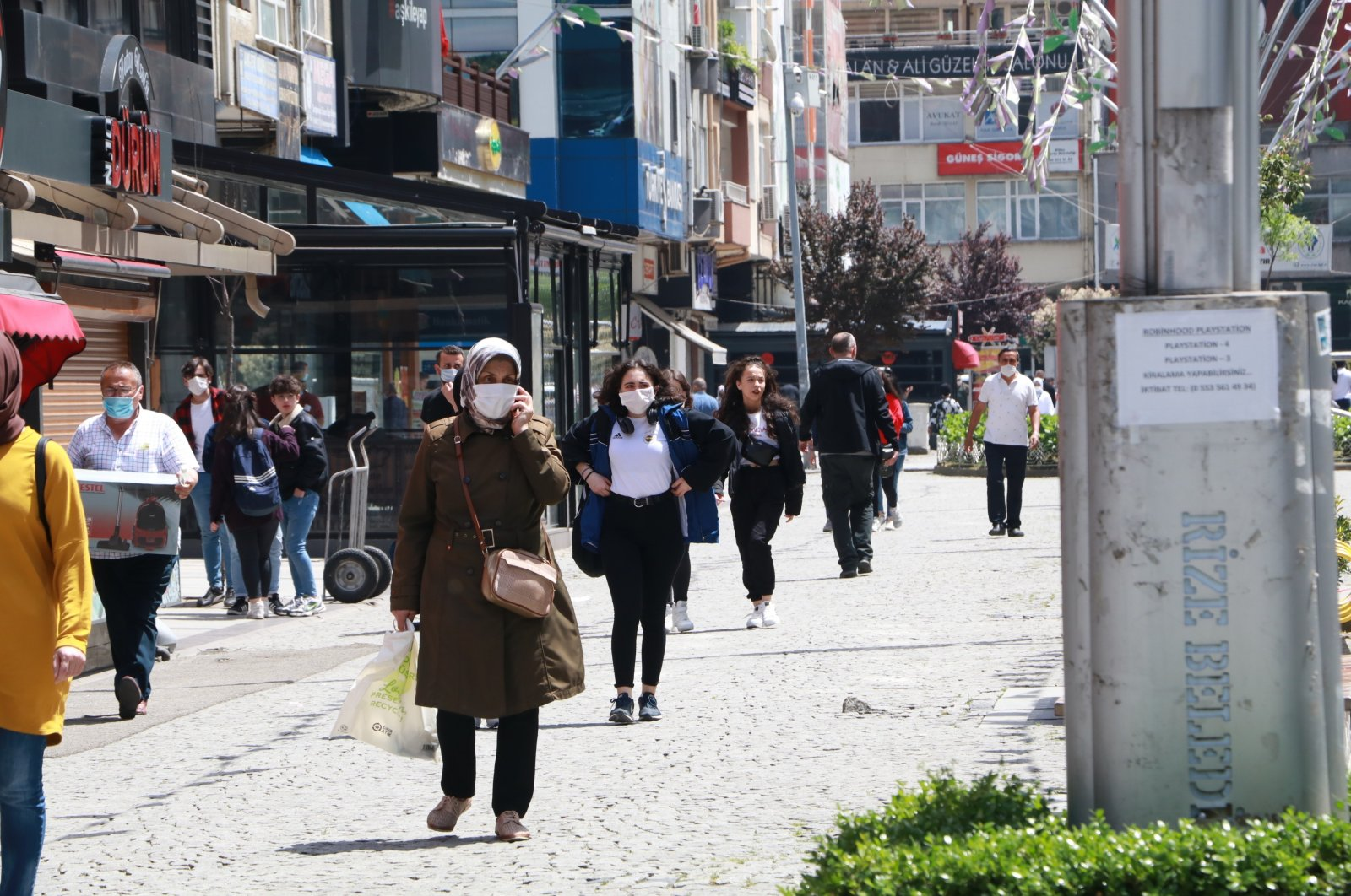 People walking on a street in Turkey's northern province Rize, July 24, 2020. (IHA Photo)