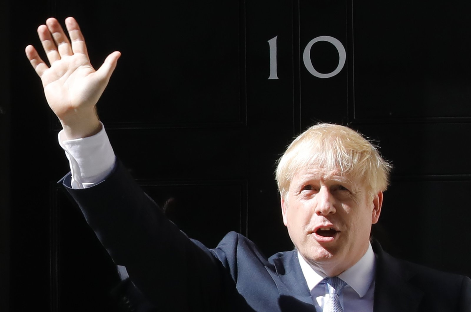 In this file photo taken on July 24, 2019 Britain's new Prime Minister Boris Johnson waves after giving a speech outside 10 Downing Street in London, the day he was formally appointed British prime minister. (AFP Photo)