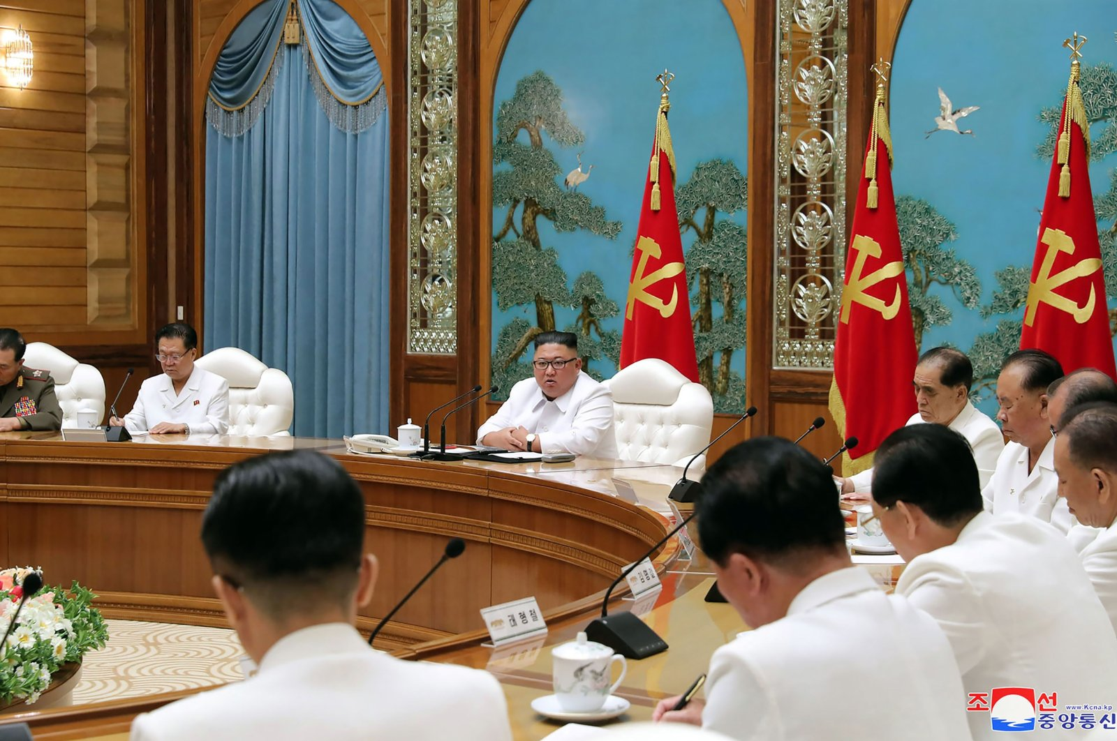 This picture taken on July 25, 2020 and released from North Korea's official Korean Central News Agency (KCNA) on July 26 shows North Korean leader Kim Jong Un (C, top) attending an emergency enlarged meeting of Political Bureau of WPK Central Committee at an undisclosed location. (AFP Photo)