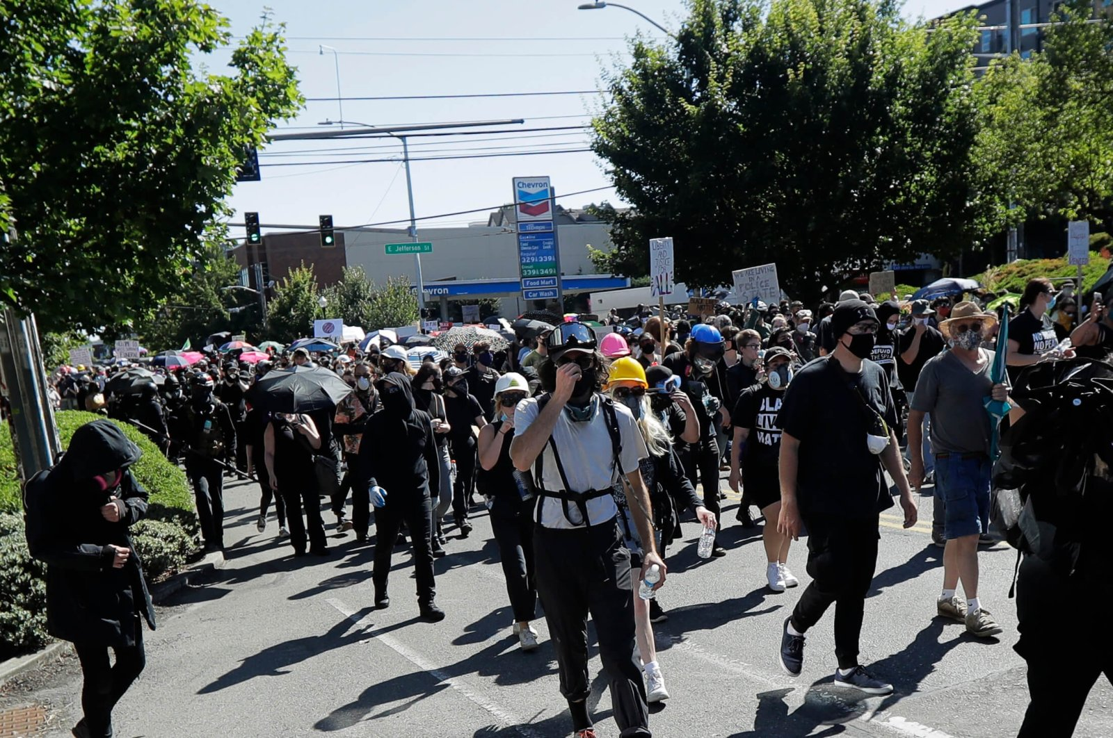 Protesters march near the King County Juvenile Detention Center, Saturday, July 25, 2020, in Seattle, in support of Black Lives Matter and against police brutality and racial injustice. (AP Photo)