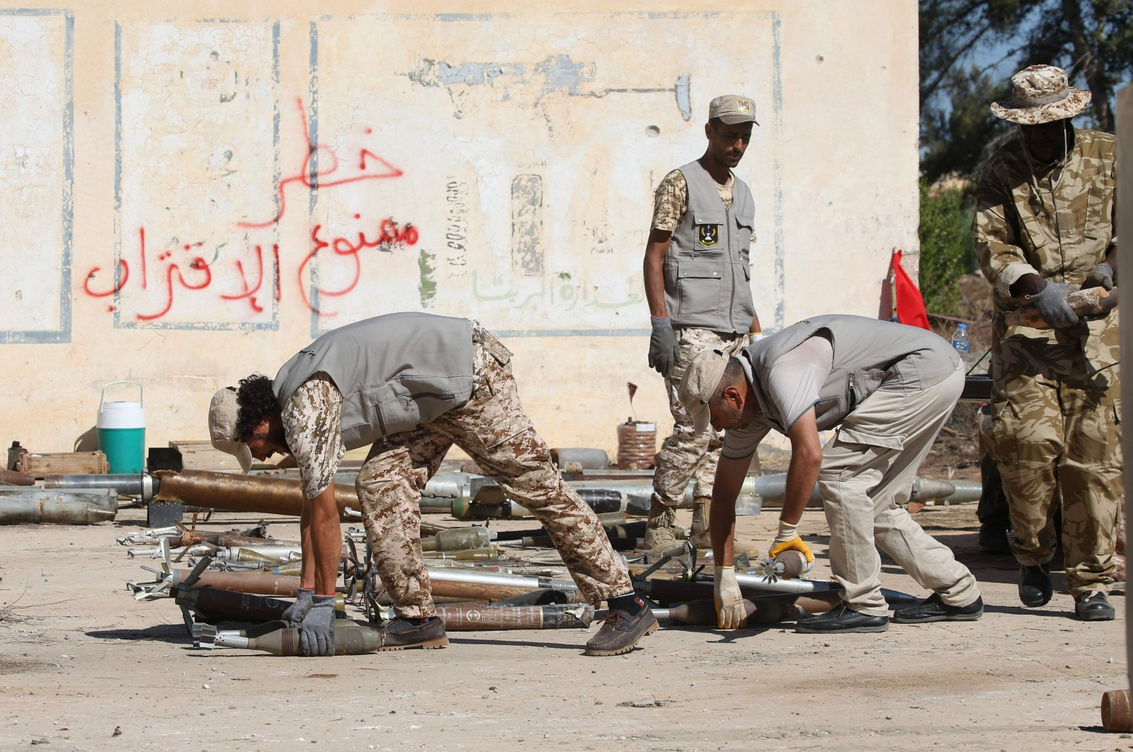 Military engineers sort ammunition and explosives, uncovered from areas south of the capital, ahead of disposing of them in the Libyan capital Tripoli, July 22, 2020. (AFP Photo)