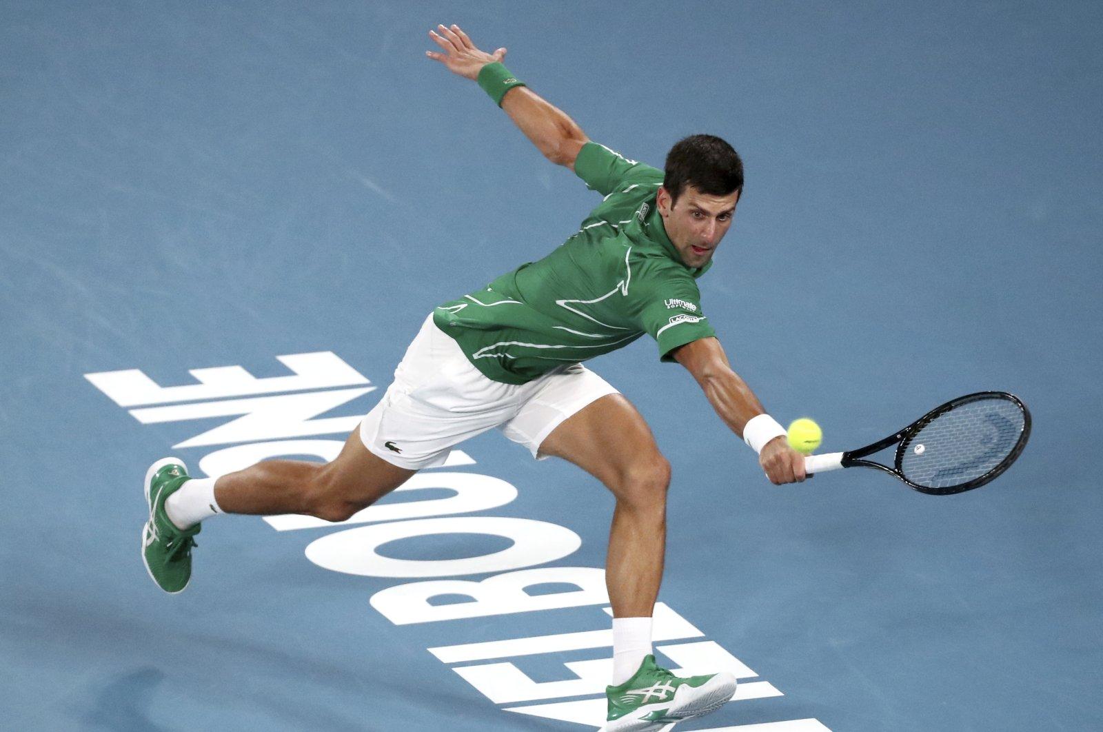 Novak Djokovic makes a backhand return to Dominic Thiem during the Australian Open final in Melbourne, Australia, Feb. 2, 2020. (AP Photo)
