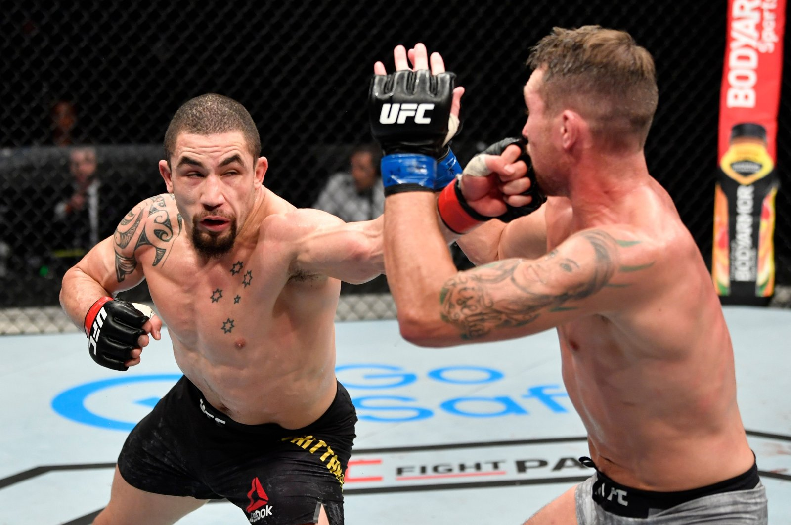 Robert Whittaker punches Darren Till in their middleweight championship fight during the UFC 251 event at UFC Fight Island on Abu Dhabi's Yas Island, UAE, July 26, 2020. (AFP Photo)