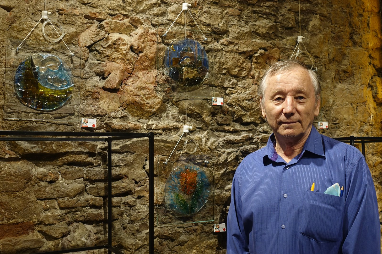Kamil Akmanov poses with his Hagia Sophia works at the exhibition, Istanbul, Turkey, July 25, 2020. (AA PHOTO)