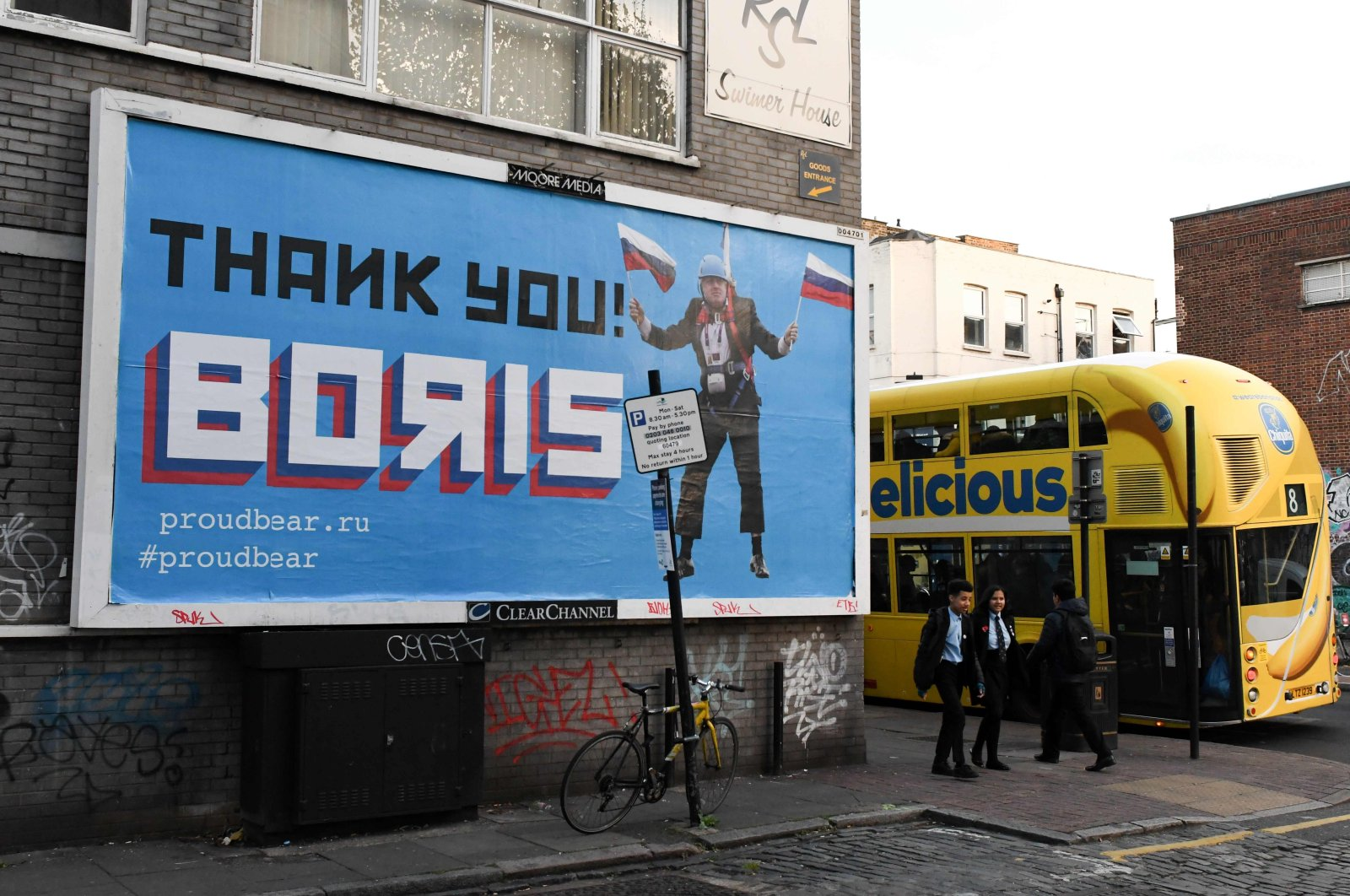 """This Nov. 8, 2018 file photo shows a Brexit-themed billboard depicting Britain's former foreign secretary Boris Johnson waving Russian national flags reading """"Thank you Boris"""" in east London. (AFP Photo)"""