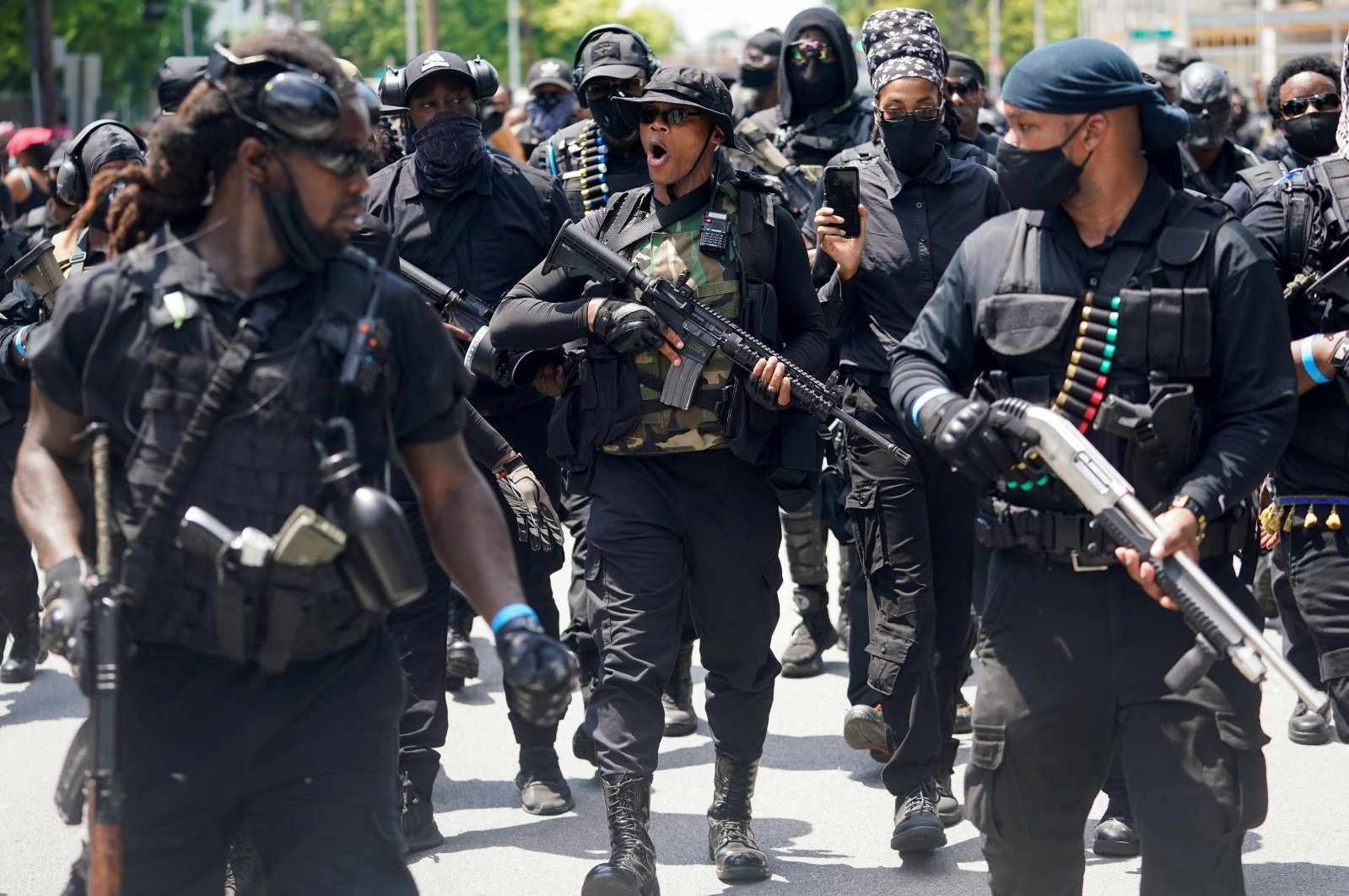 Grand Master Jay, center, leader of an all-black militia group called NFAC, leads his followers on a march during an armed rally in Louisville, Kentucky, U.S. July 25, 2020. (Reuters Photo)