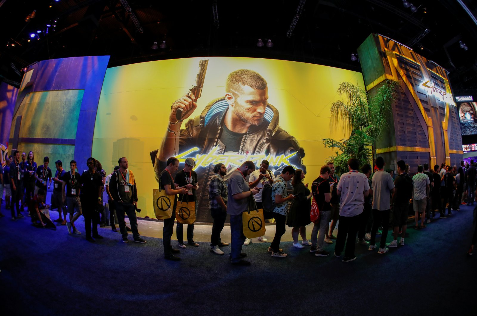 Attendees wait in line at the Cyberpunk 2077 booth during the opening day of E3, the annual video games expo revealing the latest in gaming software and hardware in Los Angeles, California, U.S., June 11, 2019. (REUTERS Photo)
