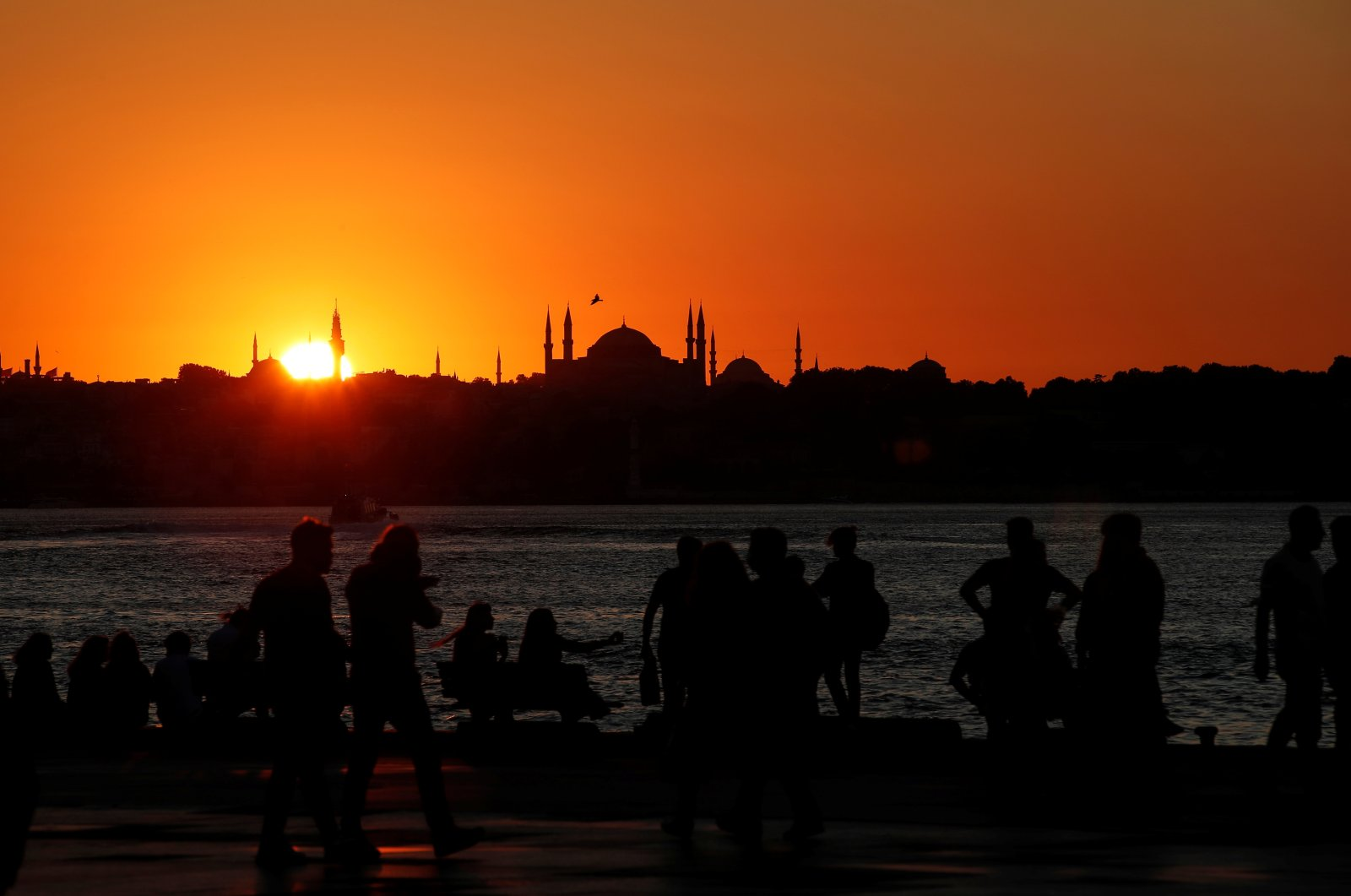 People enjoy a summer day as the sun sets in Istanbul, July 22, 2020. (Reuters Photo)