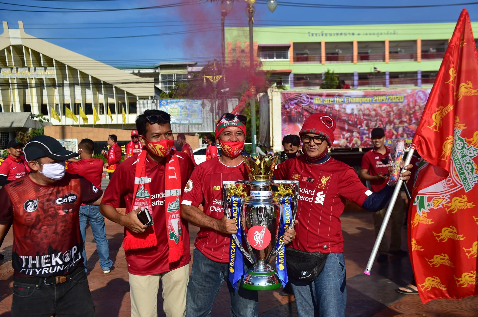 Thai fans of Liverpool Football Club celebrate the English Premier League win with a replica trophy cup as they gather for a parade in the southern Thai province of Narathiwat on July 27, 2020. (AFP Photo)