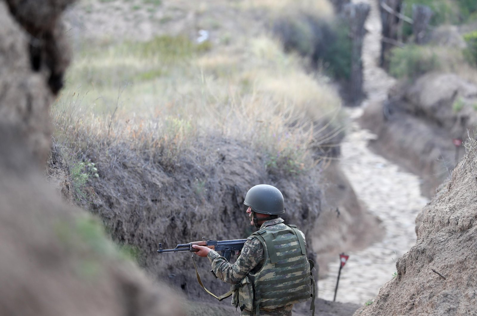 Azerbaijani soldiers patrol at the border of the Tovuz region of Azerbaijan, where deadly clashes with Armenia took place recently, July 26, 2020. (DHA Photo)