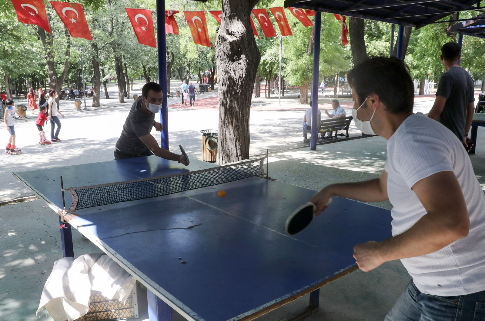Two men wearing protective masks play table tennis at Kurtuluş Park, in the capital Ankara, Turkey, July 26, 2020. (AFP Photo)