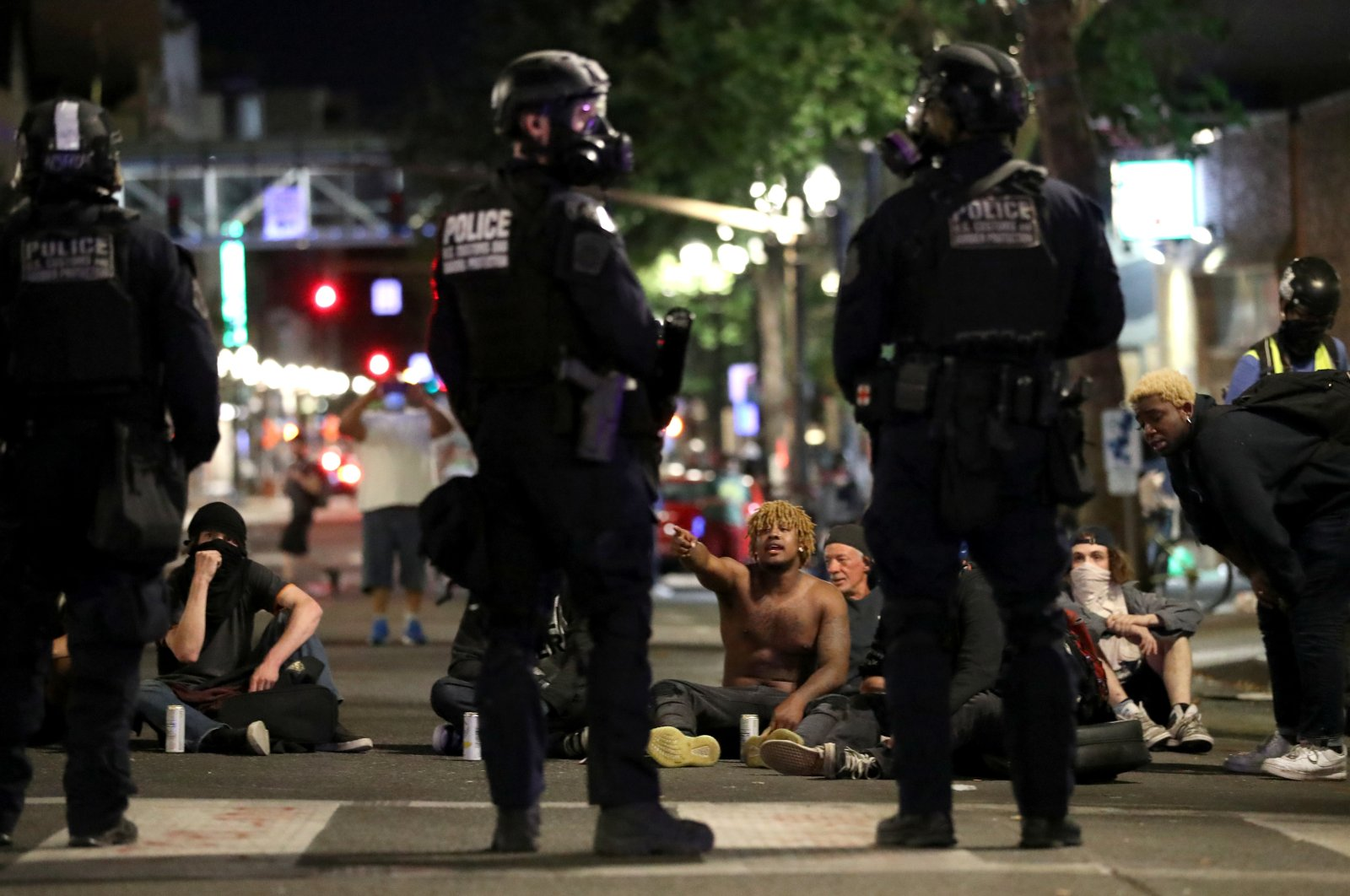 Demonstrators sit on the street during a protest against racial inequality and police violence, Portland, Oregon, U.S., July 27, 2020. (Reuters Photo)
