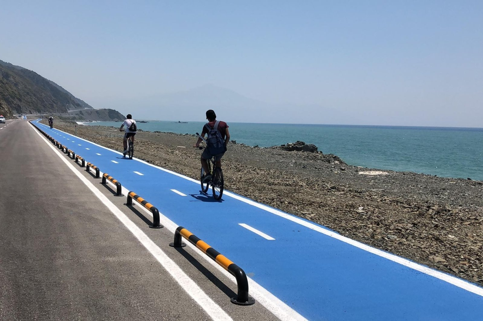 Cyclists ride on the new 25-kilometer bicycle lane, in Hatay province, southern Turkey, July 27, 2020. (IHA Photo)