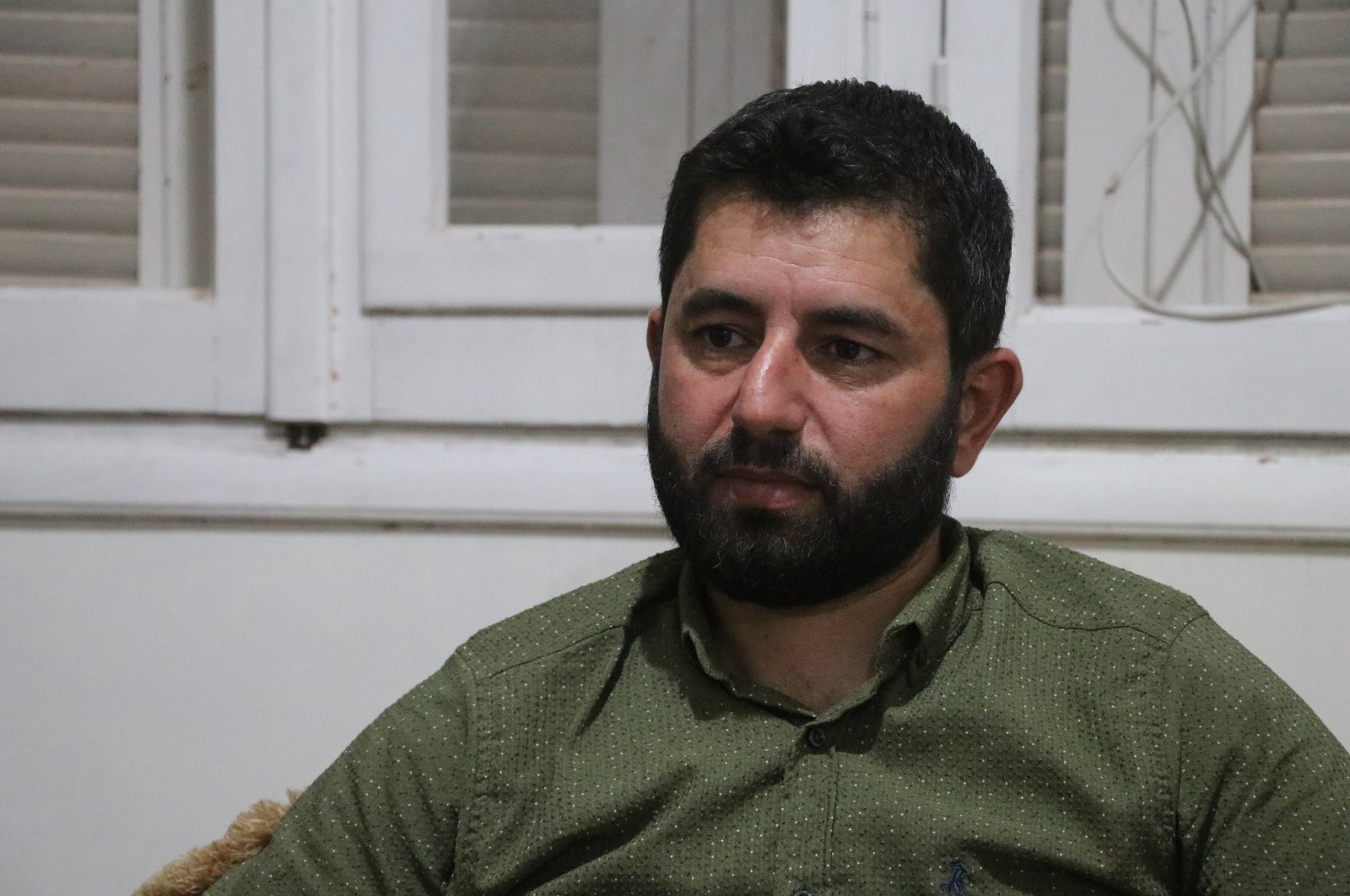 Ali Khatip, a lawyer and a member of the Syrian National Army (SNA), speaks to Anadolu Agency (AA) on his experience in Syrian regime prisons, Idlib, July 27, 2020. (AA)