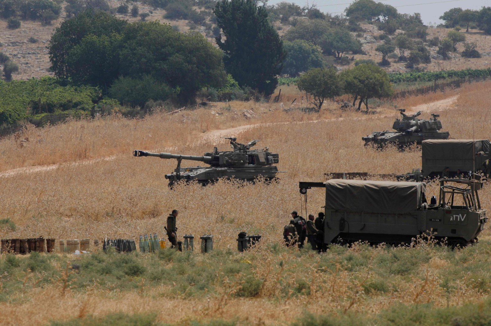 Armored vehicles and 155 mm self-propelled howitzers are deployed in the Upper Galilee in northern Israel on the border with Lebanon on July 27, 2020. (AFP Photo)