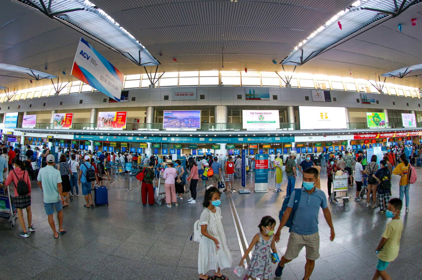 People wearing face masks at Da Nang International Airport as cases surge across the world, in Vietnam, July 26, 2020. (EPA Photo)