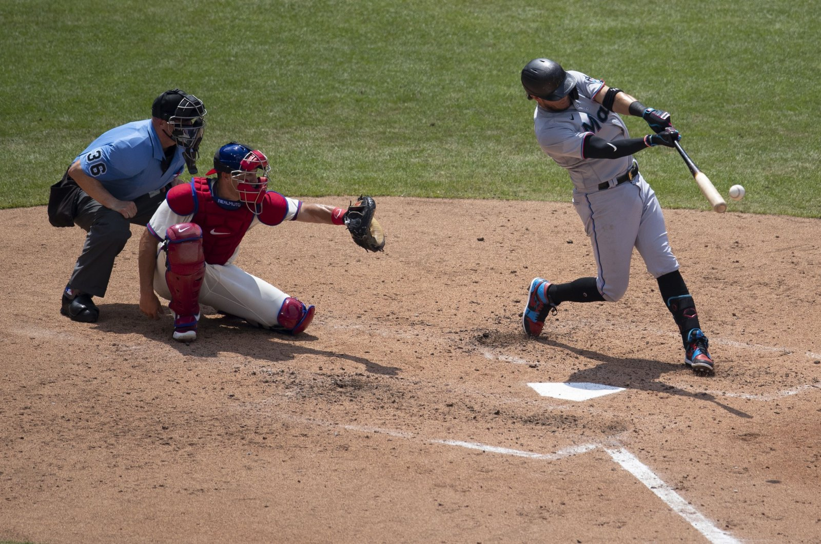 Miguel Rojas of the Miami Marlins hist an RBI triple in the top of the fourth inning against the Philadelphia Phillies in Philadelphia, PA, U.S., July 26, 2020. (AFP Photo)