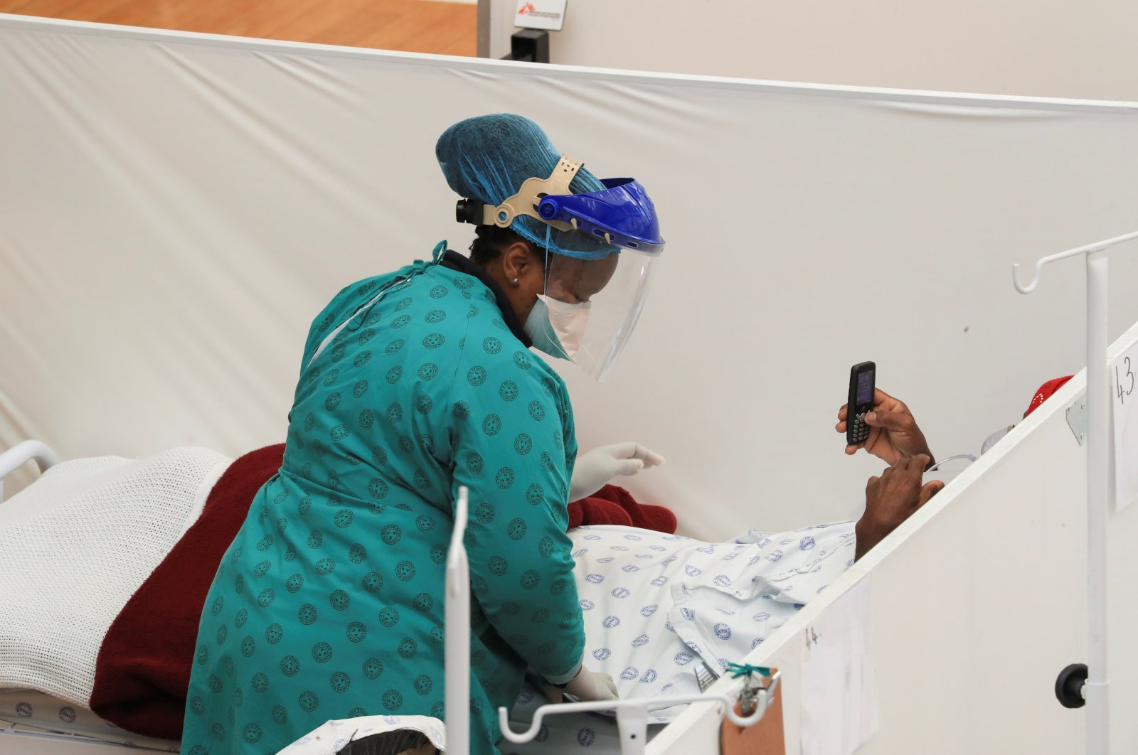 A health worker treats a patient at a temporary field hospital set up by Medecins Sans Frontieres (MSF) during the COVID-19 outbreak in Khayelitsha township near Cape Town, South Africa, July 21, 2020. (Reuters Photo)