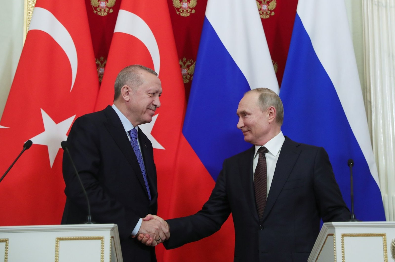 President Recep Tayyip Erdoğan shakes hand with his Russian counterpart Vladimir Putin following a press conference in Moscow, March 6, 2020. (AA Photo)