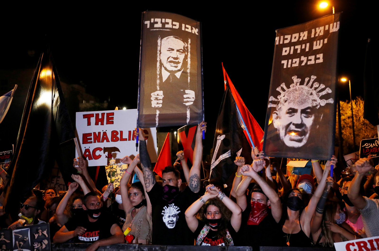 Israelis protest against Israeli Prime Minister Benjamin Netanyahu and his government's response to the financial fallout of the coronavirus crisis outside Netanyahu's residence in Jerusalem, July 21, 2020. (Reuters Photo)