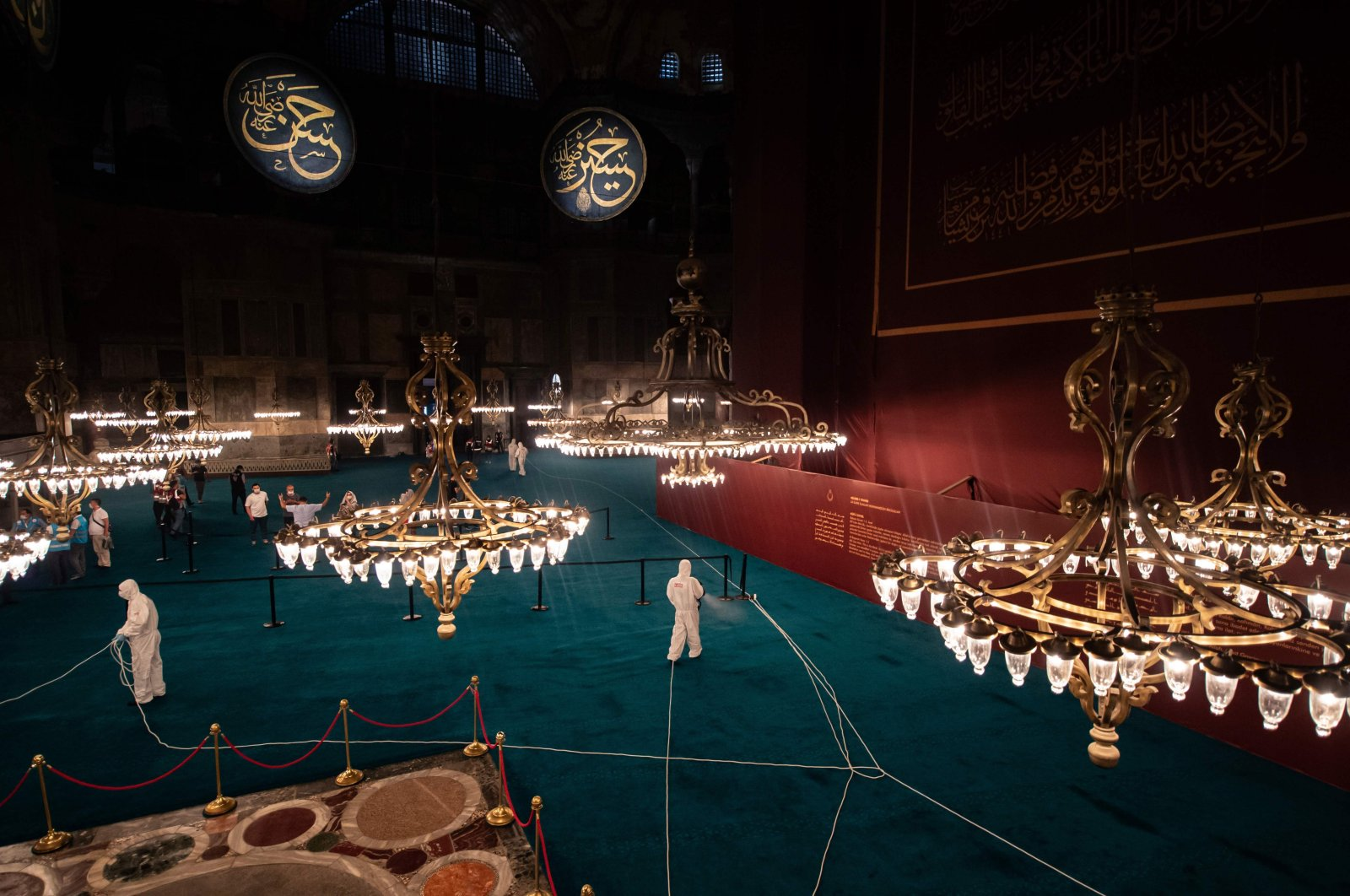 Municipality workers disinfect the interior of Hagia Sophia Grand Mosque after the night prayer in Istanbul, Turkey, July 26, 2020. (AFP Photo)