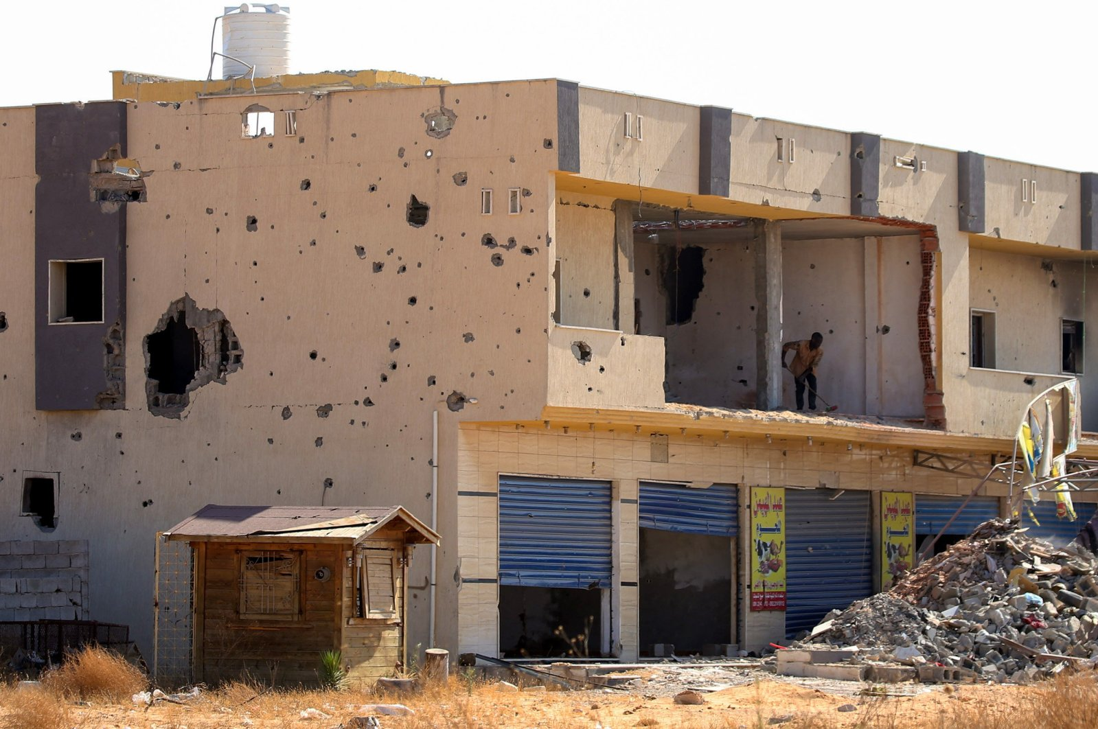 A business, damaged during the 14 months of fighting between the U.N.-recognized Government of National Accord (GNA) and forces loyal to putschist Gen. Khalifa Haftar, is seen in a southern neighborhood of the capital Tripoli, Libya, July 9, 2020. (AFP Photo)