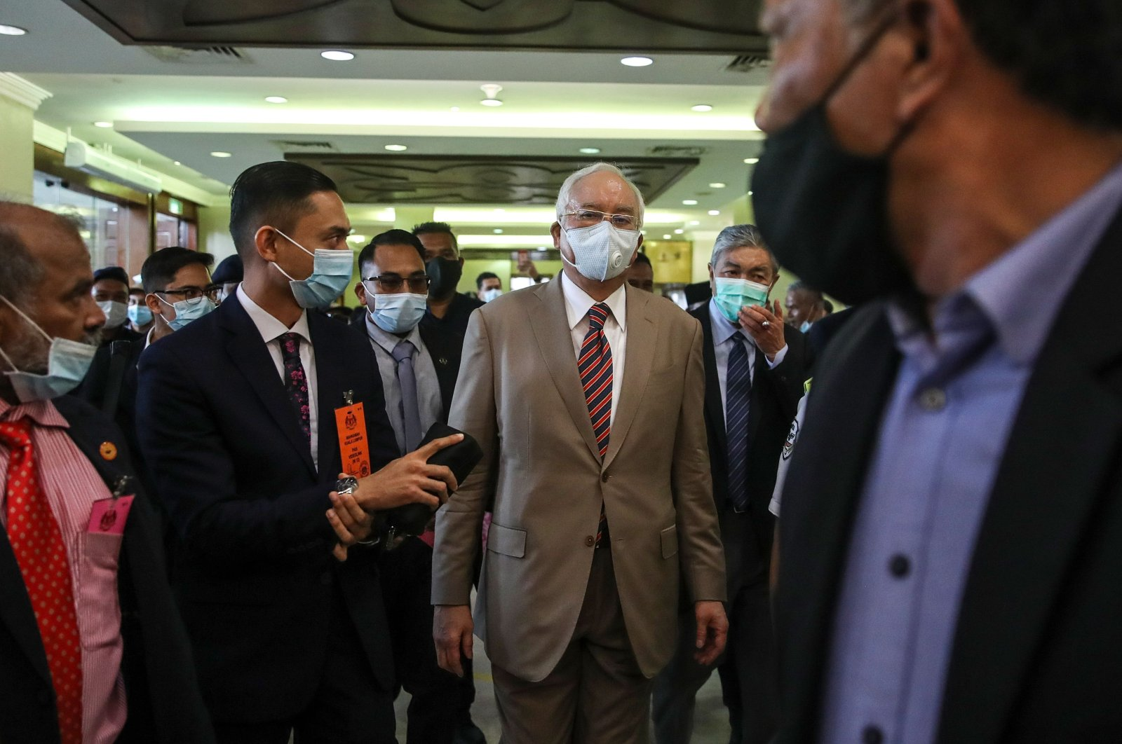 Malaysia's former Prime Minister Najib Razak (C) arrives at the Kuala Lumpur High Court complex for the verdict in his corruption trial in Kuala Lumpur on July 28, 2020. (AFP Photo)