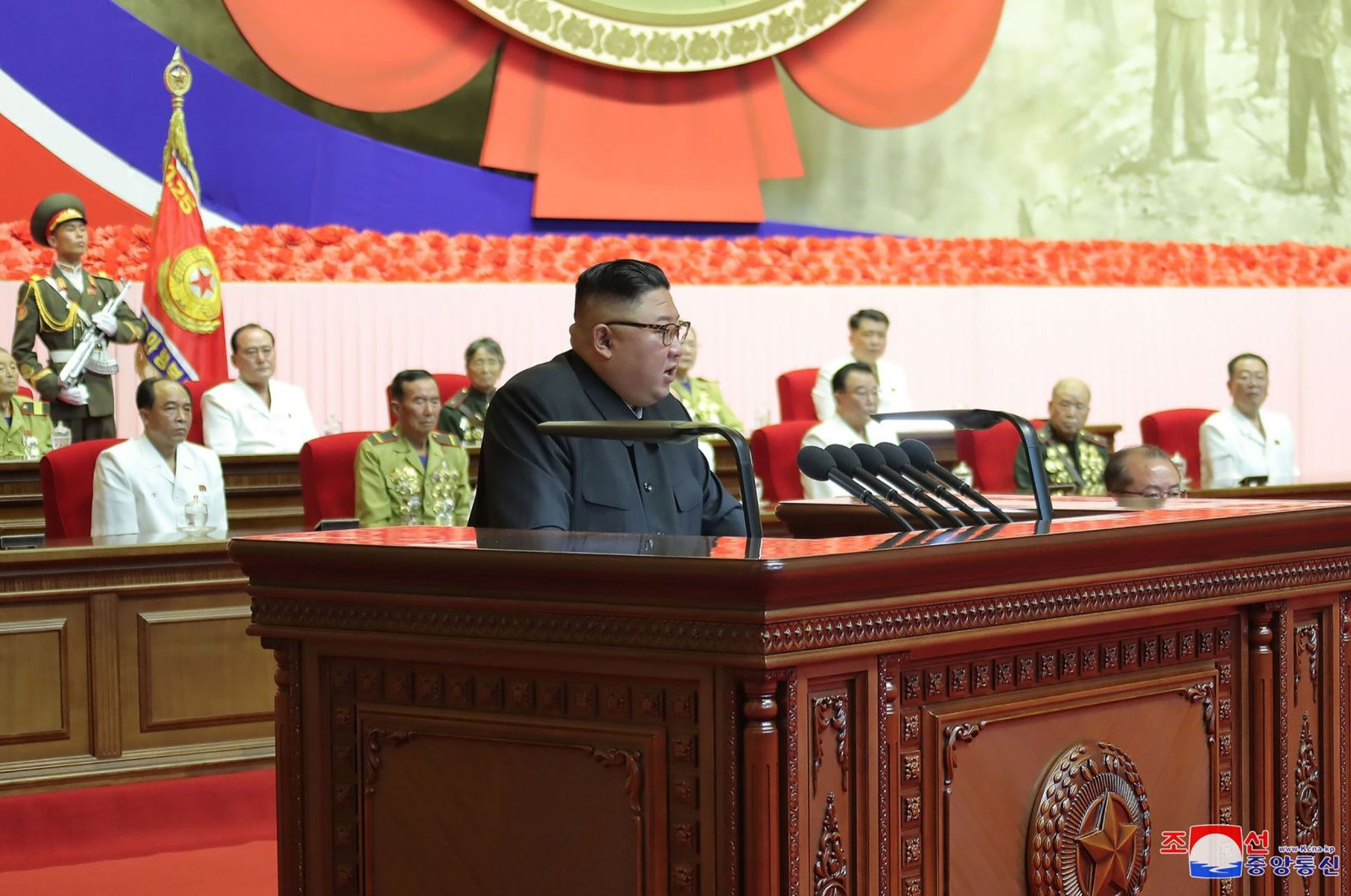 North Korean leader Kim Jong Un delivers a speech at the Sixth National Conference of War Veterans at the April 25 House of Culture, Pyongyang, July 28, 2020. (AFP Photo)