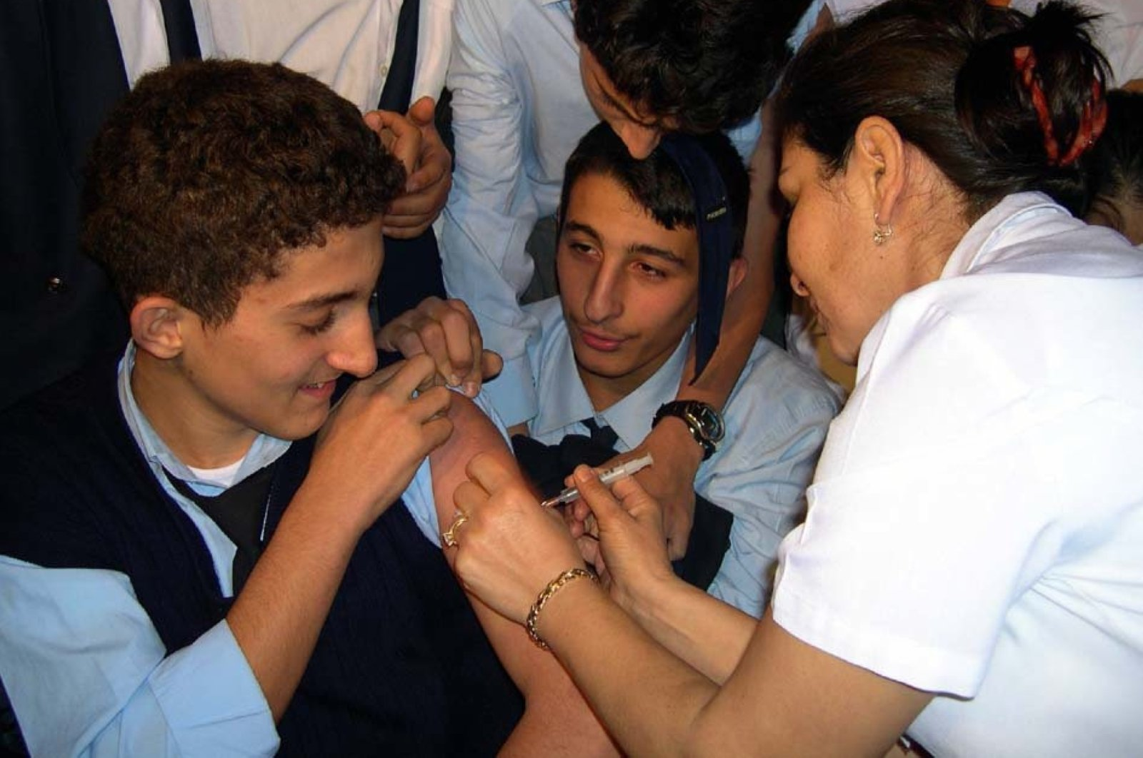 A high school student gets vaccinated against hepatitis B in the Kartal district of Istanbul, Turkey, Jan. 20, 2004. (Photo by Gülcan Demirci)