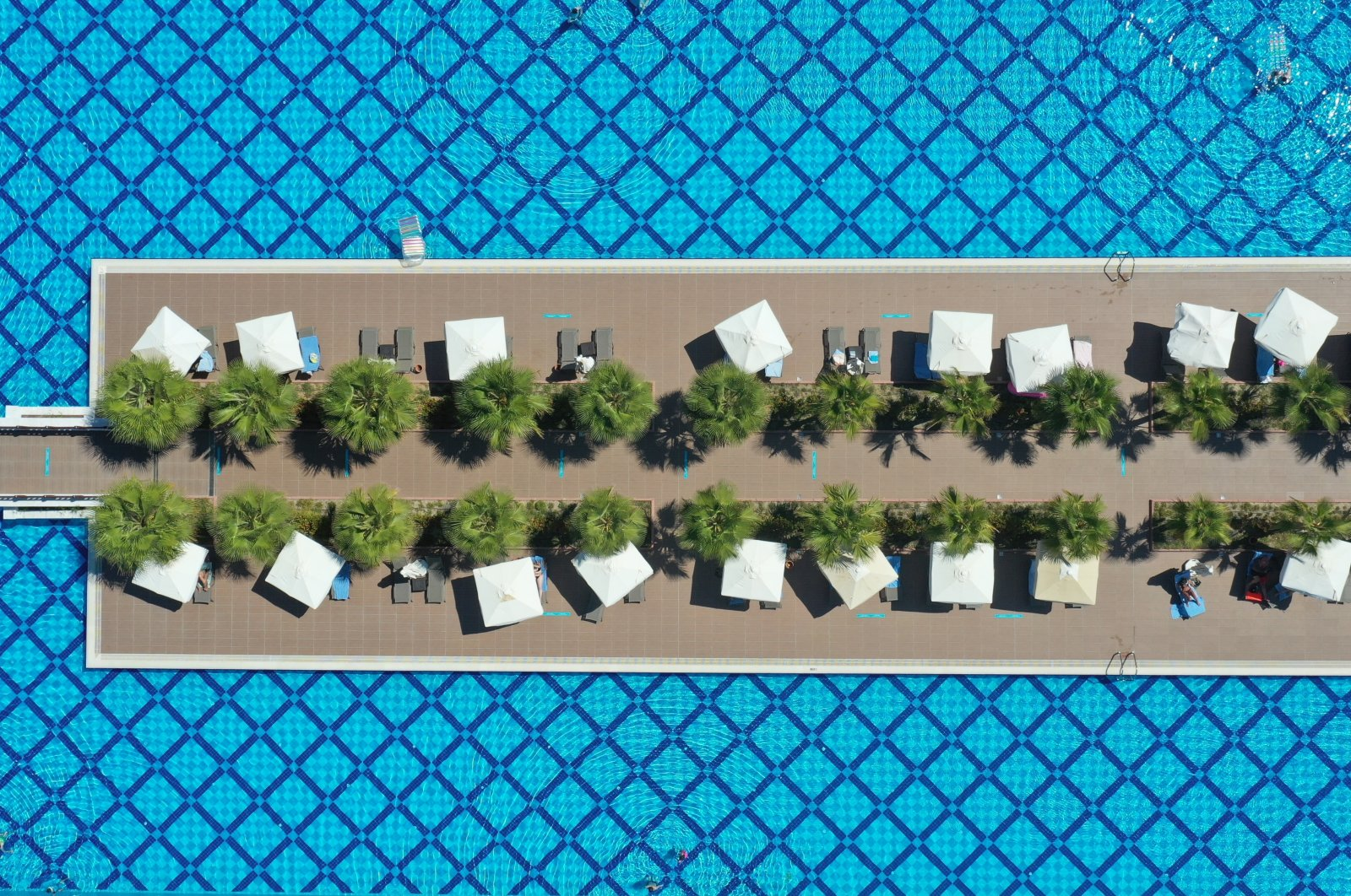 An aerial photo shows a poolside of a hotel in Didim, a popular resort town in the western province of Aydın, Turkey, July 28, 2020. (AA Photo)
