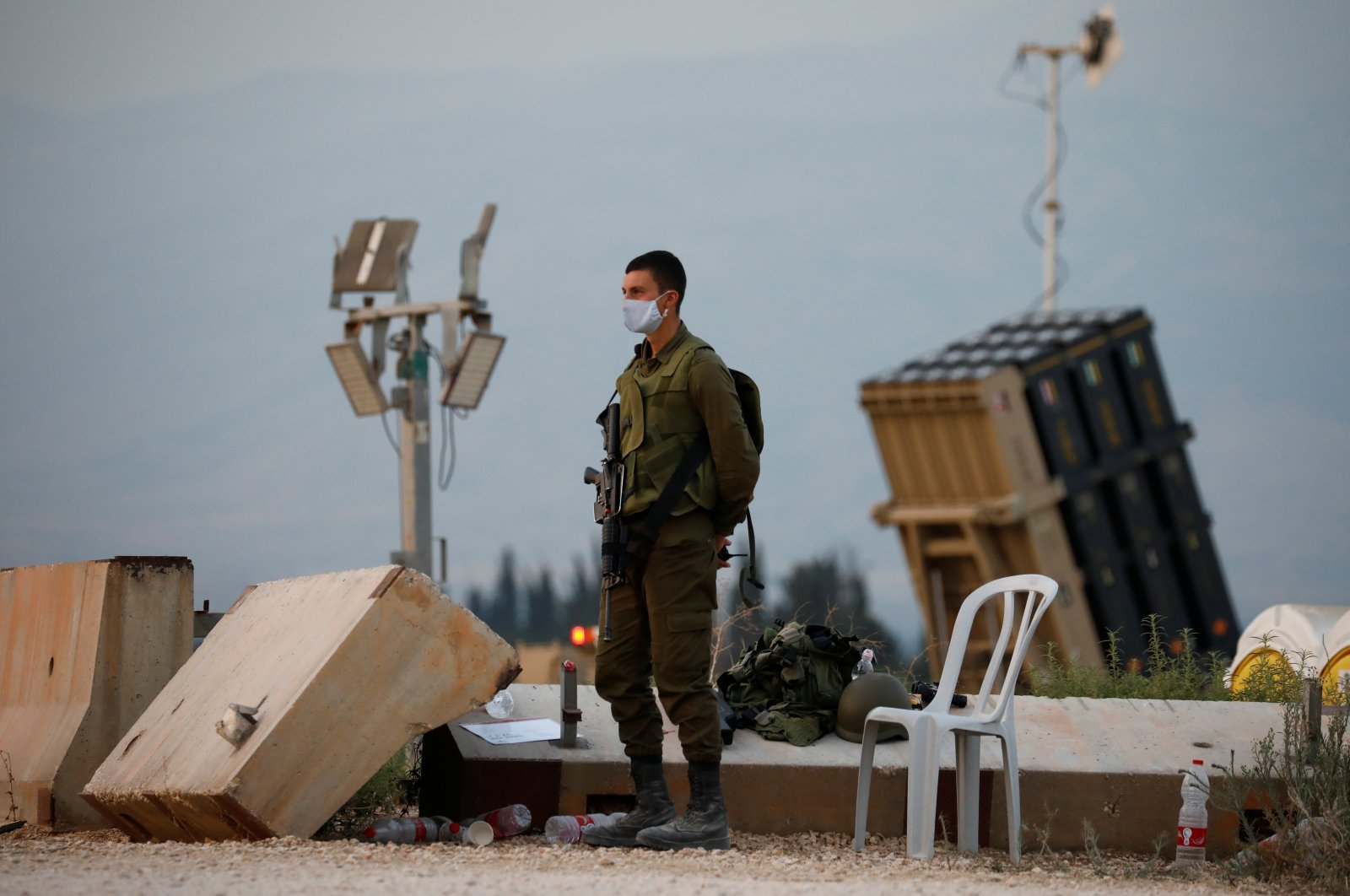 An Israeli soldier stands guard next to an Iron Dome anti-missile system near the Israel's northern border with Lebanon, July 27, 2020. (REUTERS Photo)