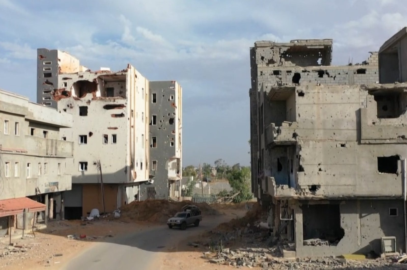 Buildings damaged during the 14 months of fighting between the U.N.-recognized Government of National Accord (GNA) and putschist Gen. Khalifa Haftar are seen in a southern neighborhood of the capital Tripoli, Libya, June 22, 2020. (AA Photo)