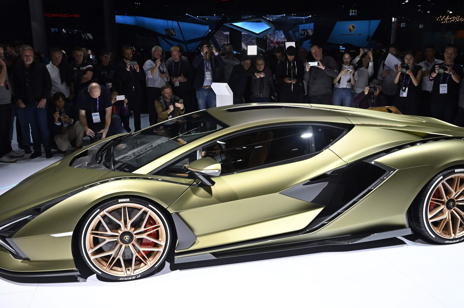 People look at a Lamborghini Sian Hybrid Car during a press day at the IAA Car Show in Frankfurt, Germany, Sept. 10, 2019. (AFP Photo)
