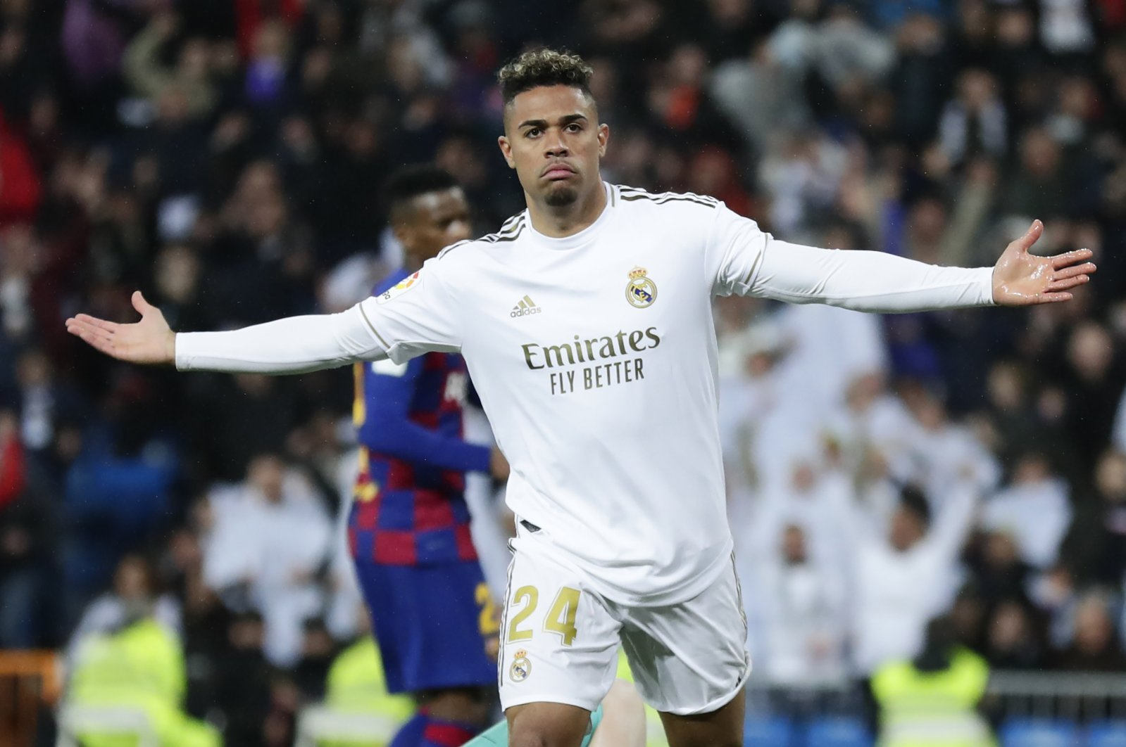Real Madrid's Mariano Diaz celebrates after scoring his side's second goal during the Spanish La Liga soccer match between Real Madrid and Barcelona at the Santiago Bernabeu stadium in Madrid, Spain, March 1, 2020. (AP Photo)