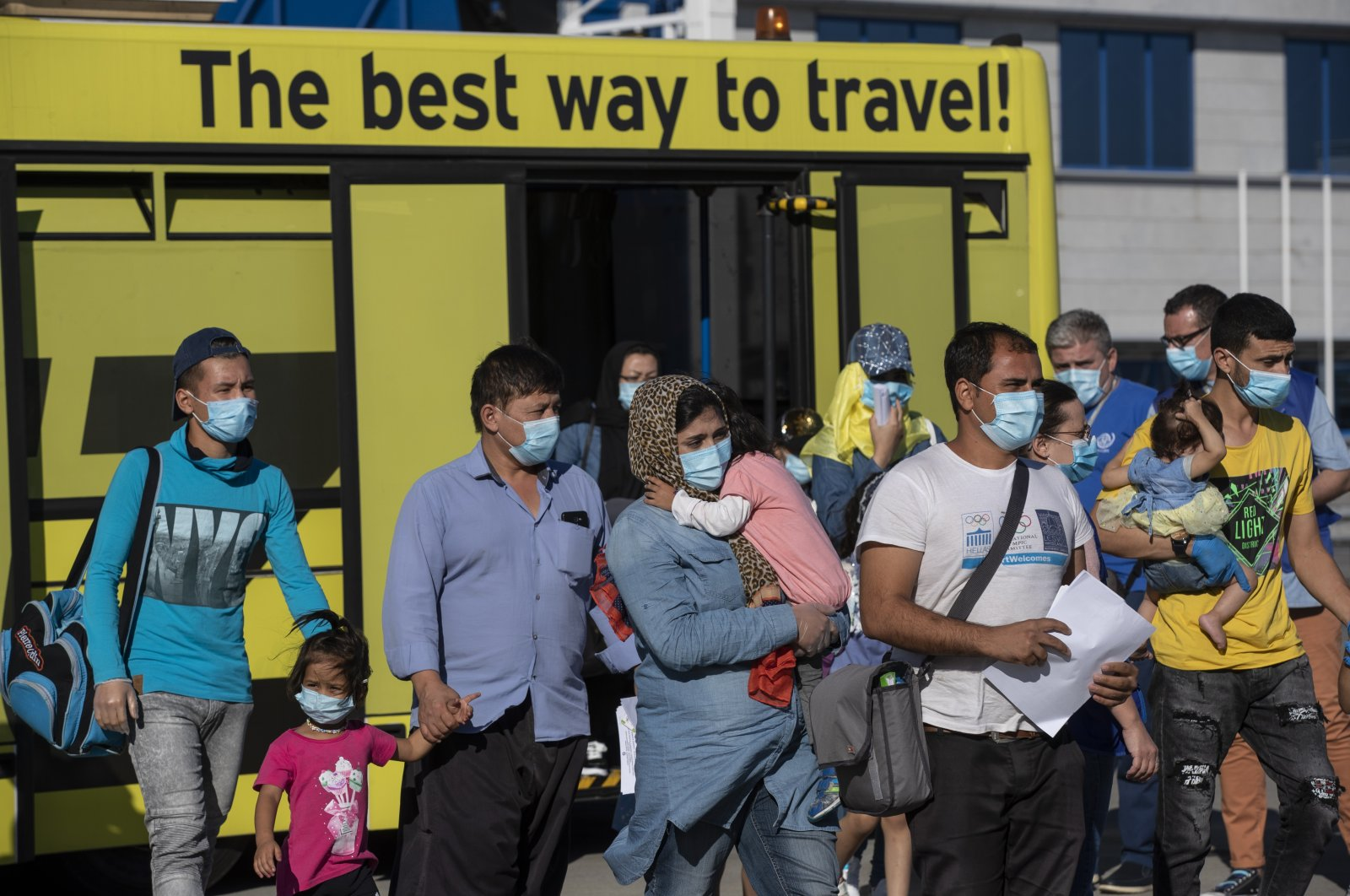 A group of migrant children with health issues board a plane to Germany, at Athens International Airport, Friday, July 24, 2020. (AP Photo)