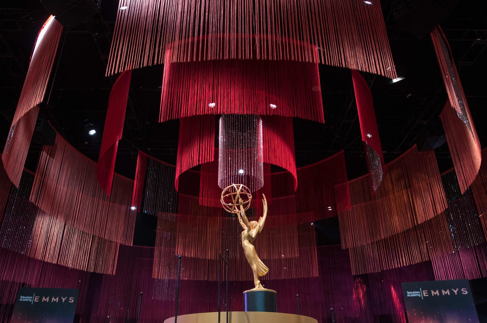 In this Sept. 12, 2019, file photo, an Emmy statue is seen on the stage at the 71st Emmy Awards Governors Ball press preview at LA Live in Los Angeles. (AFP Photo)