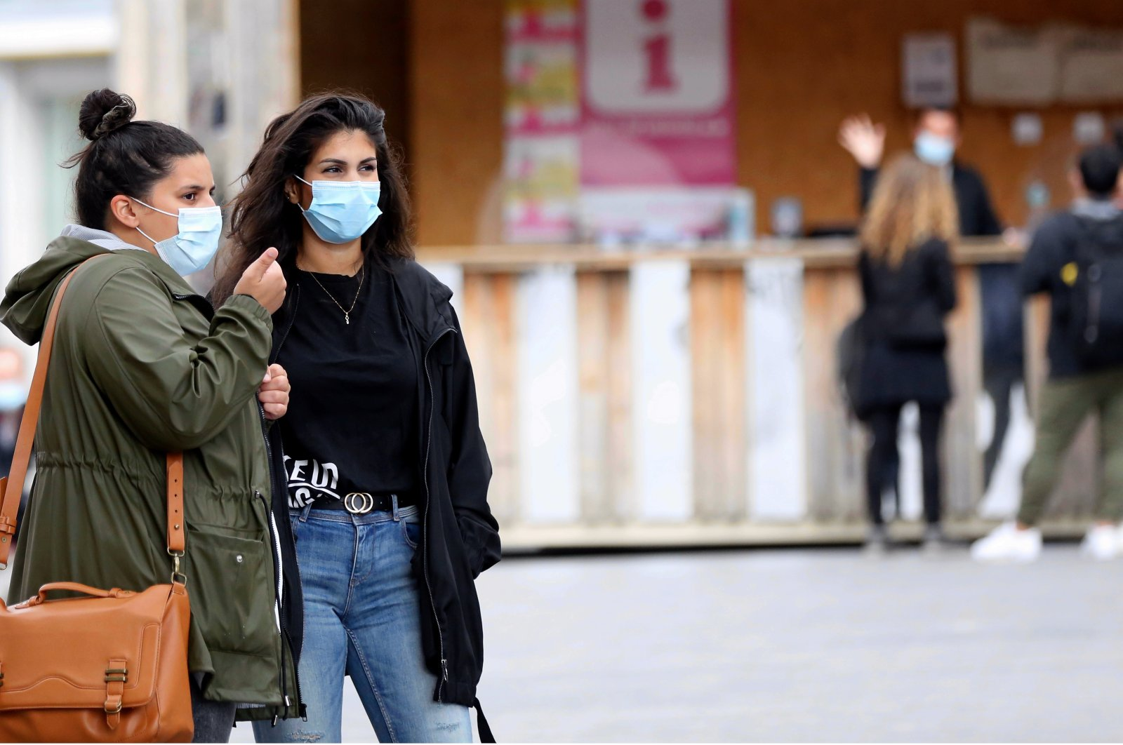 People wear protective face masks as a precaution against the coronavirus in Belgium's capital Brussels, July 28, 2020. (AA Photo)