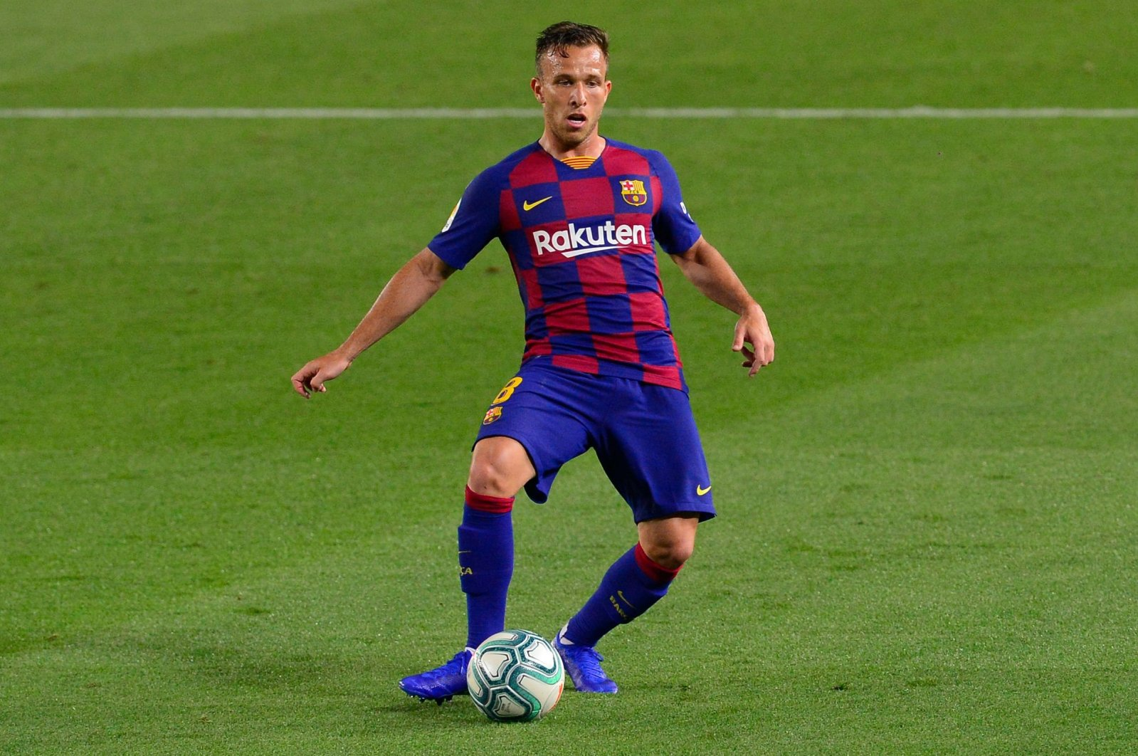 Barcelona's Brazilian midfielder Arthur controls the ball during the Spanish league football match between FC Barcelona and Athletic Club Bilbao at the Camp Nou stadium in Barcelona, Spain, June 23, 2020. (AFP Photo)