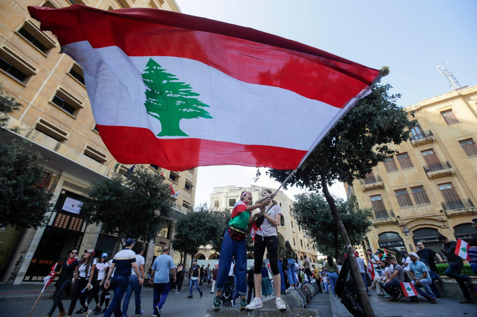 Lebanese protesters rally in downtown Beirut on the third day of demonstrations against tax increases and corruption, Lebanon, Oct. 20, 2019. (AFP Photo)