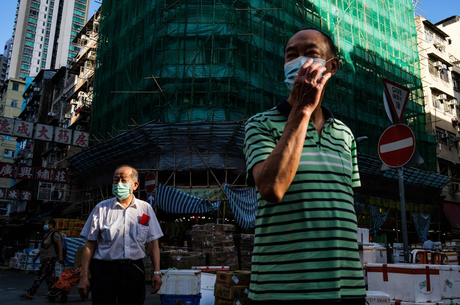 Pedestrians wear face masks in the Kowloon-side Sham Shui Po district of Hong Kong, China, in the early morning of July 29, 2020. (AFP Photo)